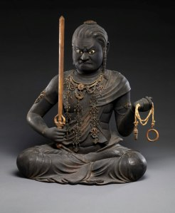 A statue depicting the wrathful face of the Bhuddist Wisdom King Fudō Myōō. 'Serenity' is the more commonly known face of Bhuddism. (more...